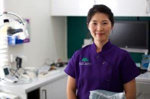 Min Song, dental assistant